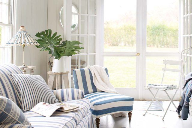 living room with striped blue couch and chair