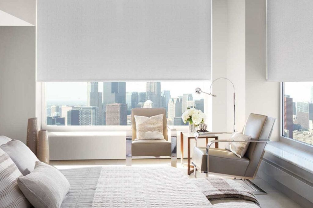 Roller Shades in modern white bedroom with city view
